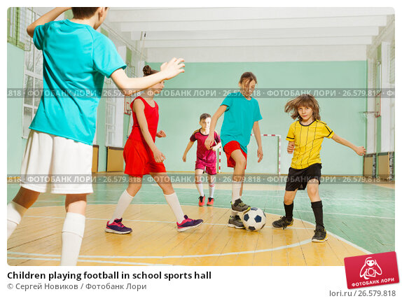 Купить «Children playing football in school sports hall», фото № 26579818, снято 16 апреля 2017 г. (c) Сергей Новиков / Фотобанк Лори