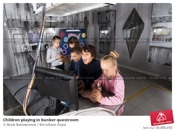 Купить «Children playing in bunker questroom», фото № 30895010, снято 21 октября 2017 г. (c) Яков Филимонов / Фотобанк Лори