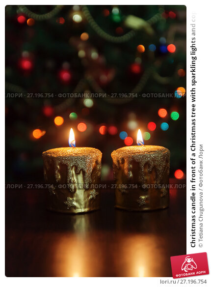 Купить «Christmas candle in front of a Christmas tree with sparkling lights and copy space.», фото № 27196754, снято 12 мая 2017 г. (c) Tetiana Chugunova / Фотобанк Лори