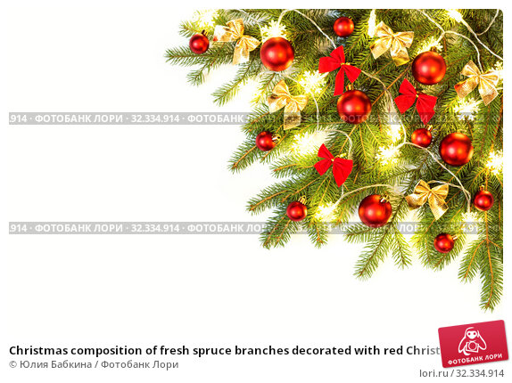 Купить «Christmas composition of fresh spruce branches decorated with red Christmas baubles, bows and snowflakes lights», фото № 32334914, снято 19 октября 2019 г. (c) Юлия Бабкина / Фотобанк Лори