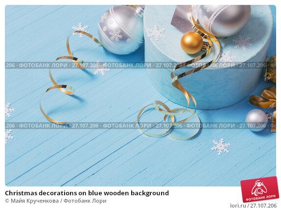 Купить «Christmas decorations on blue wooden background», фото № 27107206, снято 17 октября 2017 г. (c) Майя Крученкова / Фотобанк Лори