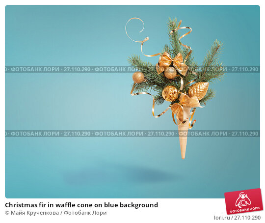 Купить «Christmas fir in waffle cone on blue background», фото № 27110290, снято 2 мая 2017 г. (c) Майя Крученкова / Фотобанк Лори