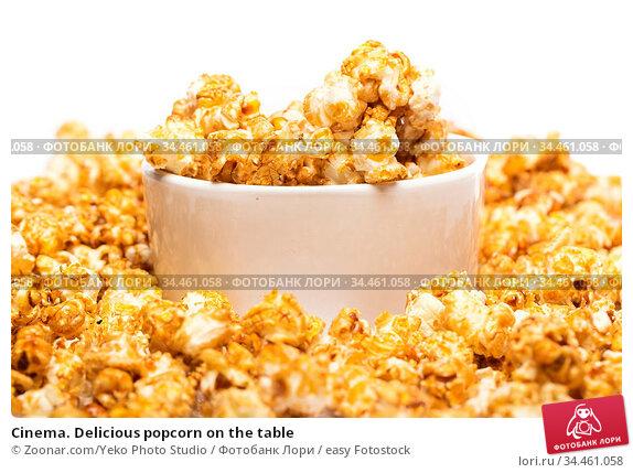 Cinema. Delicious popcorn on the table. Стоковое фото, фотограф Zoonar.com/Yeko Photo Studio / easy Fotostock / Фотобанк Лори