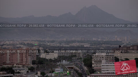 Купить «City scene with mountains. Alicante, Spain», видеоролик № 29082658, снято 19 апреля 2018 г. (c) Данил Руденко / Фотобанк Лори