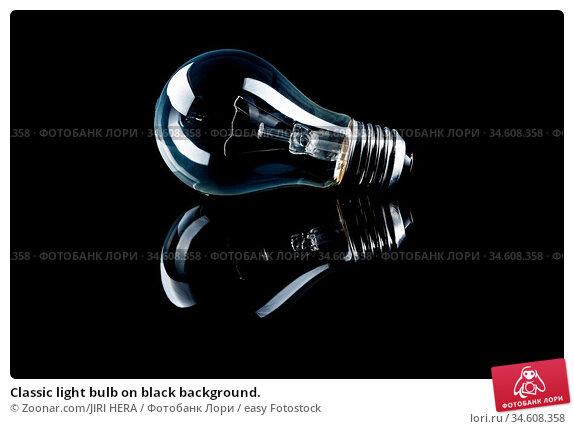 Classic light bulb on black background. Стоковое фото, фотограф Zoonar.com/JIRI HERA / easy Fotostock / Фотобанк Лори