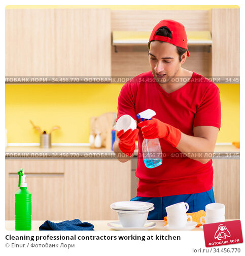 Cleaning professional contractors working at kitchen. Стоковое фото, фотограф Elnur / Фотобанк Лори