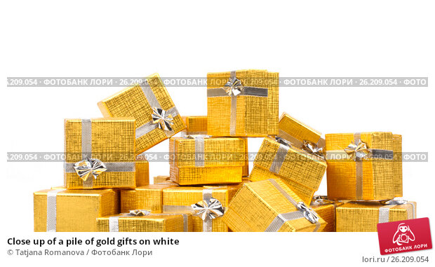 Купить «Close up of a pile of gold gifts on white», фото № 26209054, снято 18 августа 2012 г. (c) Tatjana Romanova / Фотобанк Лори