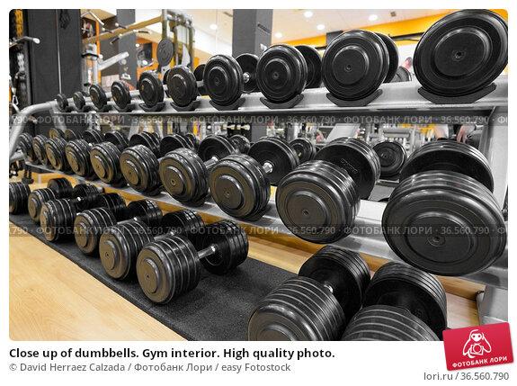 Close up of dumbbells. Gym interior. High quality photo. Стоковое фото, фотограф David Herraez Calzada / easy Fotostock / Фотобанк Лори