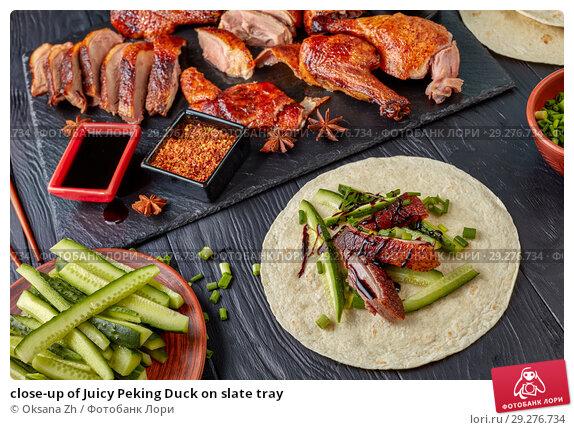 Купить «close-up of Juicy Peking Duck on slate tray», фото № 29276734, снято 15 октября 2018 г. (c) Oksana Zh / Фотобанк Лори