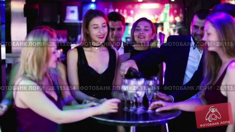 Colleagues dancing on corporate party with cocktails in hands. Стоковое видео, видеограф Яков Филимонов / Фотобанк Лори