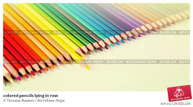 Купить «colored pencils lying in row», фото № 29920234, снято 11 января 2017 г. (c) Татьяна Яцевич / Фотобанк Лори