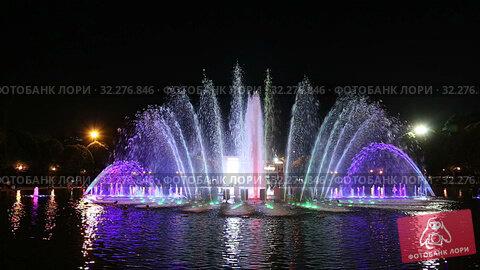 Купить «Colorful Lights of the Dancing Fountain in Gorky Park (at night), Moscow, Russia», видеоролик № 32276846, снято 10 октября 2019 г. (c) Владимир Журавлев / Фотобанк Лори