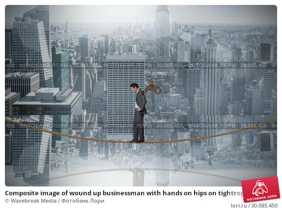 Купить «Composite image of wound up businessman with hands on hips on tightrope», фото № 30085450, снято 11 июня 2014 г. (c) Wavebreak Media / Фотобанк Лори