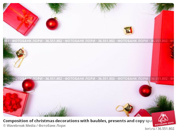 Composition of christmas decorations with baubles, presents and copy space on white background. Стоковое фото, агентство Wavebreak Media / Фотобанк Лори