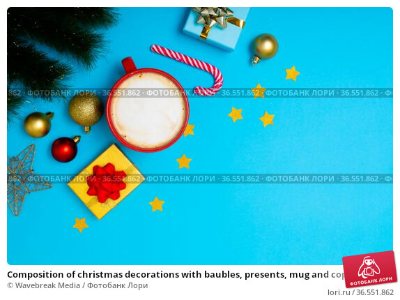 Composition of christmas decorations with baubles, presents, mug and copy space on blue background. Стоковое фото, агентство Wavebreak Media / Фотобанк Лори