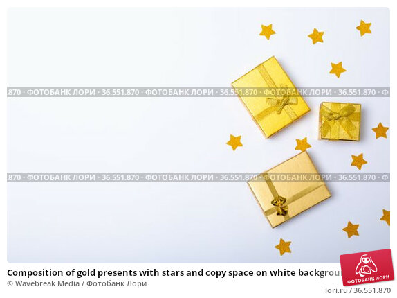 Composition of gold presents with stars and copy space on white background. Стоковое фото, агентство Wavebreak Media / Фотобанк Лори