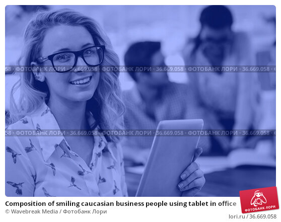 Composition of smiling caucasian business people using tablet in office. Стоковое фото, агентство Wavebreak Media / Фотобанк Лори