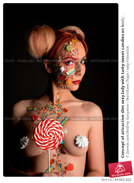 Concept of attractive slim sexy lady with tasty sweet candies on body... Стоковое фото, фотограф Zoonar.com/Andrey Guryanov / easy Fotostock / Фотобанк Лори