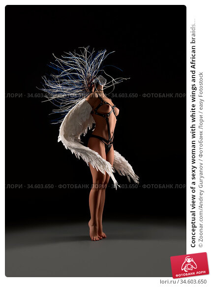 Conceptual view of a sexy woman with white wings and African braids... Стоковое фото, фотограф Zoonar.com/Andrey Guryanov / easy Fotostock / Фотобанк Лори