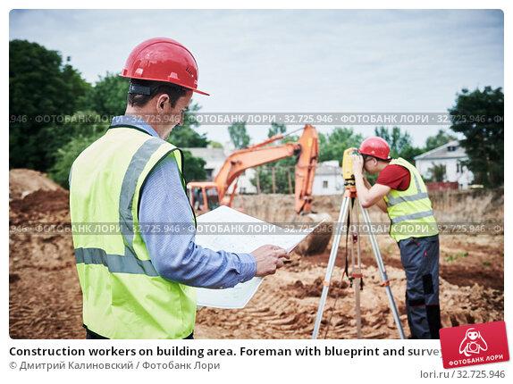 Купить «Construction workers on building area. Foreman with blueprint and surveyoor», фото № 32725946, снято 21 июня 2018 г. (c) Дмитрий Калиновский / Фотобанк Лори
