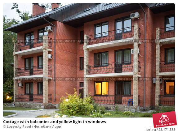 Купить «Cottage with balconies and yellow light in windows», фото № 28171538, снято 26 августа 2015 г. (c) Losevsky Pavel / Фотобанк Лори