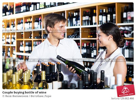 Купить «Couple buying bottle of wine», фото № 29662466, снято 20 марта 2019 г. (c) Яков Филимонов / Фотобанк Лори