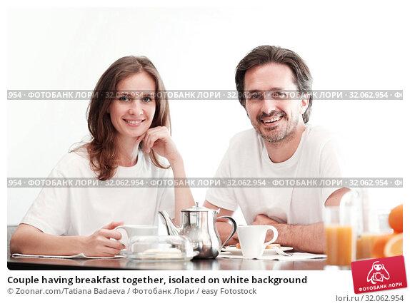 Couple having breakfast together, isolated on white background. Стоковое фото, фотограф Zoonar.com/Tatiana Badaeva / easy Fotostock / Фотобанк Лори
