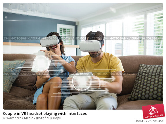 Купить «Couple in VR headset playing with interfaces», фото № 26706354, снято 23 апреля 2019 г. (c) Wavebreak Media / Фотобанк Лори