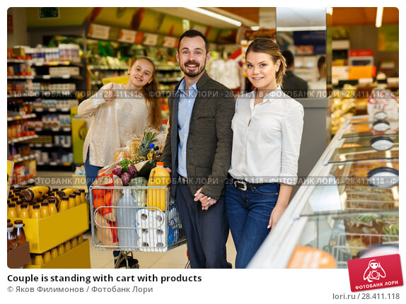 Купить «Couple is standing with cart with products», фото № 28411118, снято 4 апреля 2018 г. (c) Яков Филимонов / Фотобанк Лори