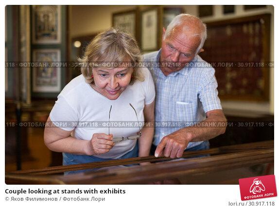 Купить «Couple looking at stands with exhibits», фото № 30917118, снято 12 мая 2019 г. (c) Яков Филимонов / Фотобанк Лори
