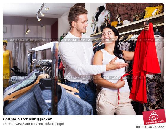 Купить «Couple purchasing jacket», фото № 30252586, снято 24 октября 2016 г. (c) Яков Филимонов / Фотобанк Лори