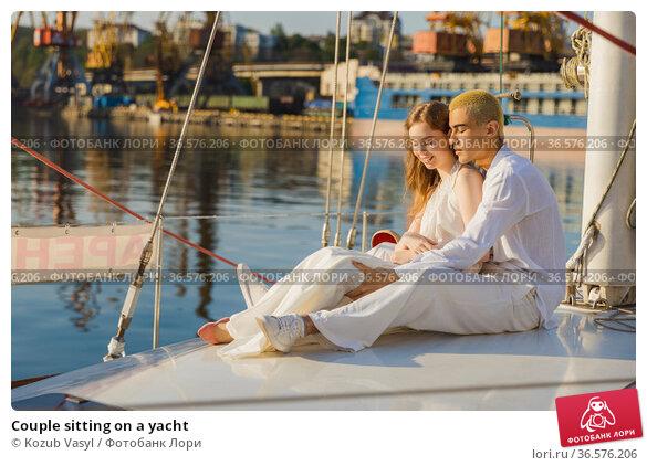 Couple sitting on a yacht. Стоковое фото, фотограф Kozub Vasyl / Фотобанк Лори