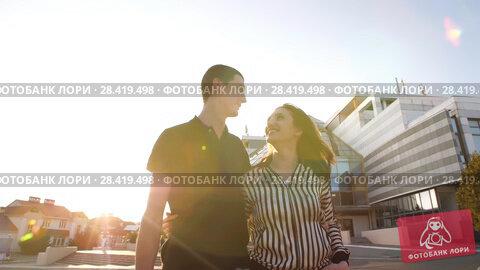 Купить «Couple walking at city», видеоролик № 28419498, снято 7 мая 2018 г. (c) Илья Шаматура / Фотобанк Лори