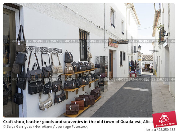 Купить «Craft shop, leather goods and souvenirs in the old town of Guadalest, Alicante, Spain», фото № 28250138, снято 30 января 2018 г. (c) age Fotostock / Фотобанк Лори