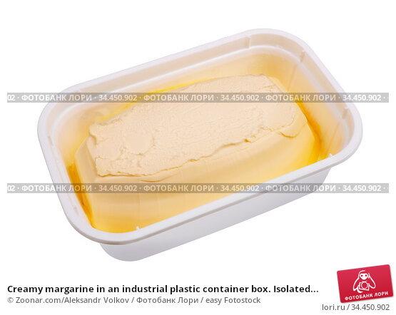 Creamy margarine in an industrial plastic container box. Isolated... Стоковое фото, фотограф Zoonar.com/Aleksandr Volkov / easy Fotostock / Фотобанк Лори