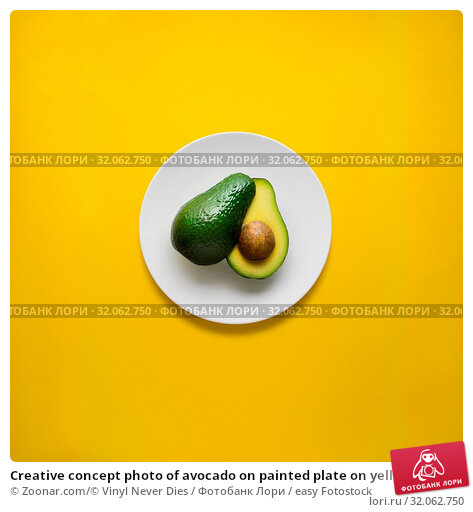 Creative concept photo of avocado on painted plate on yellow background. Стоковое фото, фотограф Zoonar.com/© Vinyl Never Dies / easy Fotostock / Фотобанк Лори