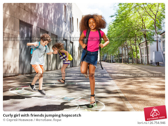 Купить «Curly girl with friends jumping hopscotch», фото № 26754946, снято 17 июня 2017 г. (c) Сергей Новиков / Фотобанк Лори