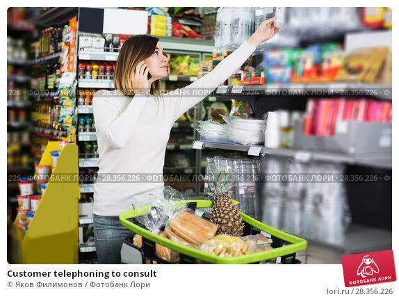 Купить «Customer telephoning to consult», фото № 28356226, снято 23 ноября 2016 г. (c) Яков Филимонов / Фотобанк Лори