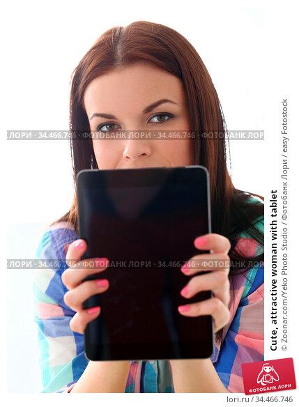 Cute, attractive woman with tablet. Стоковое фото, фотограф Zoonar.com/Yeko Photo Studio / easy Fotostock / Фотобанк Лори