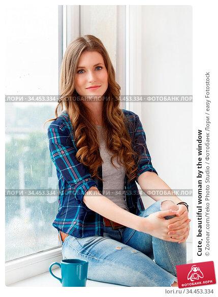Cute, beautiful woman by the window. Стоковое фото, фотограф Zoonar.com/Yeko Photo Studio / easy Fotostock / Фотобанк Лори