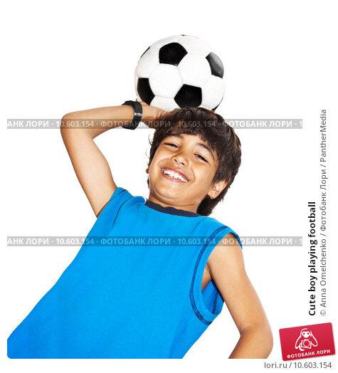 Cute boy playing football. Стоковое фото, фотограф Anna Omelchenko / PantherMedia / Фотобанк Лори