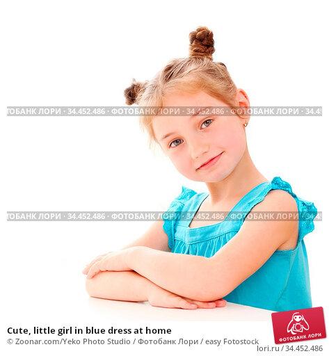 Cute, little girl in blue dress at home. Стоковое фото, фотограф Zoonar.com/Yeko Photo Studio / easy Fotostock / Фотобанк Лори