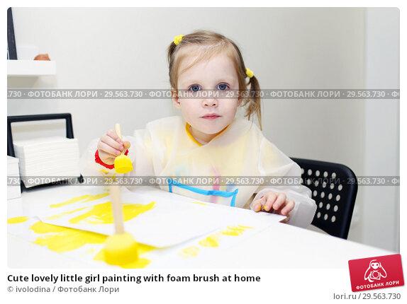 Купить «Cute lovely little girl painting with foam brush at home», фото № 29563730, снято 11 декабря 2018 г. (c) ivolodina / Фотобанк Лори