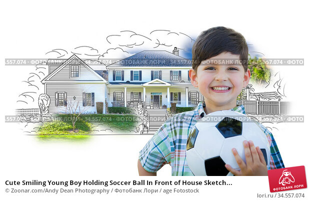 Cute Smiling Young Boy Holding Soccer Ball In Front of House Sketch... Стоковое фото, фотограф Zoonar.com/Andy Dean Photography / age Fotostock / Фотобанк Лори