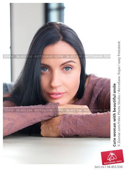 Cute woman with beautiful smile. Стоковое фото, фотограф Zoonar.com/Yeko Photo Studio / easy Fotostock / Фотобанк Лори