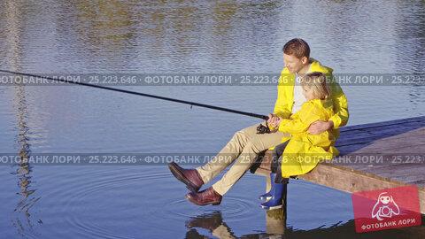 Купить «Dad and son fishing outdoors», видеоролик № 25223646, снято 23 ноября 2019 г. (c) Raev Denis / Фотобанк Лори