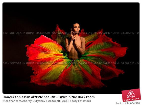 Dancer topless in artistic beautiful skirt in the dark room. Стоковое фото, фотограф Zoonar.com/Andrey Guryanov / easy Fotostock / Фотобанк Лори