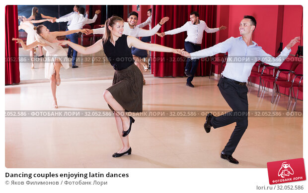 Dancing couples enjoying latin dances. Стоковое фото, фотограф Яков Филимонов / Фотобанк Лори