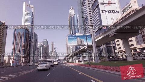 Купить «Day traffic on the Sheikh Zayed Road stock footage video», видеоролик № 28790846, снято 8 апреля 2018 г. (c) Юлия Машкова / Фотобанк Лори