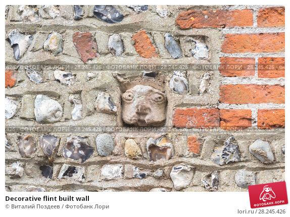 Купить «Decorative flint built wall», фото № 28245426, снято 13 апреля 2017 г. (c) Виталий Поздеев / Фотобанк Лори